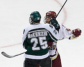 Jim McKenzie (Michigan State - Woodbury, MN) and Mike Brennan (Boston College - Smithtown, NY) battle. The Michigan State Spartans defeated the Boston College Eagles 3-1 (EN) to win the national championship in the final game of the 2007 Frozen Four at the Scottrade Center in St. Louis, Missouri on Saturday, April 7, 2007.