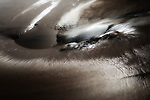 Abstract wet sand at Legzira beach in Morocco.