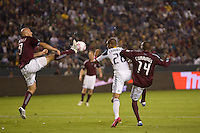 Conor Casey of the Colorado Rapids puches the ball past teammate Omar Cummings and Sean Franklin of the LA Galaxy. The Colorado Rapids defeated the LA Galaxy 3-1 at Home Depot Center stadium in Carson, California on Saturday October 16, 2010.