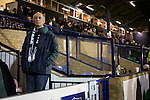 Southend United 1 Burton Albion 1, 22/02/2016. Roots Hall, League One. A home supporter waiting for the teams to come on to the pitch at Roots Hall stadium, before Southend United took on Burton Albion in a League 1 fixture. Founded in 1906, Southend United moved into their current ground in 1955, the construction of which was funded by the club's supporters. Southend won this match by 3-1, watched by a crowd of 6503. Photo by Colin McPherson.