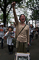 October 15, 2011, Tokyo, Japan - A protester raises a fist into the air during a speech at a Occupy Tokyo protest in Shinjuku. Around 500 protesters took part in 3 separate protests in support of the Occupy Tokyo movement. The protesters airing a series of issues including Anti-Nuclear, Anti-Capitalism and Anti-TPP. They chanted '1% no thank you' and ' Nuclear no thank you ' at the rallies. Protesters in the Roppongi's Mikawadai Park numbered about 60 and were out numbered by around 70 Police and 40 members of the media. (Photo by Bruce Meyer-Kenny/AFLO) [3692]