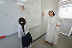 Sister Muntahah Haday teaches a class at the Al Bishara School, which is run by the Dominican Sisters of St. Catherine of Siena in Ankawa, near Erbil, Iraq. The students and the Dominican Sisters themselves were displaced by ISIS in 2014. The nuns have established schools and other ministries among the displaced.