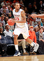 CHARLOTTESVILLE, VA- DECEMBER 6: Mike Scott #23 of the Virginia Cavaliers handles the ball during the game on December 6, 2011 against the George Mason Patriots at the John Paul Jones Arena in Charlottesville, Virginia. Virginia defeated George Mason 68-48. (Photo by Andrew Shurtleff/Getty Images) *** Local Caption *** Mike Scott