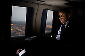 United States President Barack Obama reads from a tablet computer during a flight aboard Marine One en route to Everett, Washington, February 17, 2012. .Mandatory Credit: Pete Souza - White House via CNP