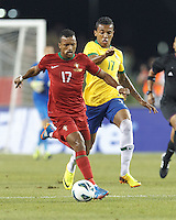 Portugal forward Nani (17)brings the ball forward as Brazil midfielder Luiz Gustavo (17) closes. In an international friendly, Brazil (yellow/blue) defeated Portugal (red), 3-1, at Gillette Stadium on September 10, 2013.