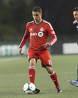 Toronto FC forward Luis Silva (11) passes the ball.  In a Major League Soccer (MLS) match, the New England Revolution (blue) defeated Toronto FC (red), 2-0, at Gillette Stadium on May 25, 2013.