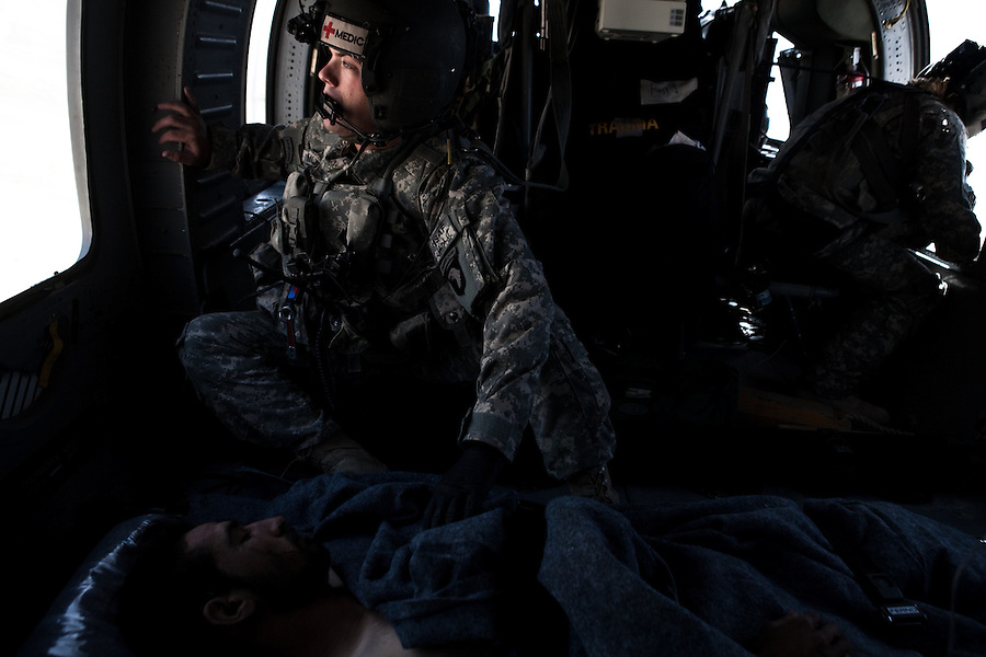 """Scenes from the medical evacuations of wounded Americans, Canadians, and Afghan civilians and soldiers being flown by Charlie Co. 6th Battalion 101st Aviation Regiment of the 101st Airborne Division. Charlie Co. - which flies under the call-sign """"Shadow Dustoff"""" - flies into rush the wounded to medical care out of bases scattered across Oruzgan, Kandahar, and Helmand Provinces in the Afghan south. These images were taken of missions flown out of Kandahar Airfield in Kandahar Province and Camp Dwyer in Helmand Province."""