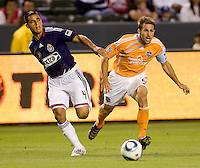 CD Chivas USA defender Michael Umana (4) battles with Houston Dynamo forward Brian Mullan (9). The Houston Dynamo defeated CD Chivas USA 2-0 at Home Depot Center stadium in Carson, California on Saturday May 8, 2010.  .
