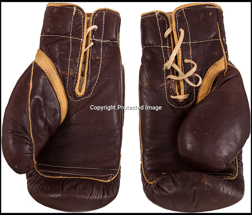 BNPS.co.uk (01202 558833)<br /> Pic: HeritageAuctions/BNPS<br /> <br /> ***Please use full byline***<br /> <br /> its a knockout - Muhammed Ali's gloves from his historic victory over Sonny Liston in 1964 have sold for a world record &pound;520,000 at auction last night.<br /> <br /> The boxing gloves were worn by the then Cassius Clay when against all odds he claimed the Heavyweight Championship of the world on 25th February 1964.<br /> <br /> Liston was the most intimidating fighter at the time and the match was one of the most anticipated in the sport's history.<br /> <br /> Clay, weighing in at 210lbs and Liston, at 218lbs, fought for seven rounds before the former heavyweight retired and Clay was declared the winner by technical knockout.<br /> <br /> The hammer finally went down at $836,500 over &pound;200,000 more than the estimate.
