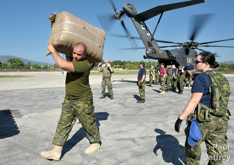 Canadian military personnel unload emergency supplies from a U.S. Navy Blackhawk helicopter in the earthquake-ravaged Haitian city of Jacmel on January 22. The aid was provided by Diakonie, part of the ACT Alliance, in a joint operation with Caritas Internationalis.