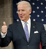 United States Vice President Joe Biden gives a thumbs-up before U.S. President Barack Obama's State of the Union address in front of a joint session of Congress on Tuesday, January 24, 2012 at the US Capitol in Washington, DC. .Credit: Saul Loeb / Pool via CNP