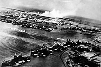 Captured Japanese photograph taken during the attack on Pearl Harbor, December 7, 1941.  In the distance, the smoke rises from Hickam Field.  (Navy)<br /> NARA FILE #:  080-G-30550<br /> WAR &amp; CONFLICT BOOK #:  1133