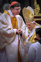 Pope Benedict XVI (L) gives his cardinal ring to Swiss Kurt Koch (R) during the Eucharistic celebration with the new cardinals on November 21, 2010 at St Peter's basilica at The Vatican. 24 Roman Catholic prelates joined the day before the Vatican's College of Cardinals, the elite body that advises the pontiff and elects his successor upon his death