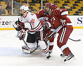 Dylan Wiwchar (NU - 32), Chris Huxley (Harvard - 28), Ryan Grimshaw (Harvard - 6) - The Northeastern University Huskies defeated the Harvard University Crimson 4-1 (EN) on Monday, February 8, 2010, at the TD Garden in Boston, Massachusetts, in the 2010 Beanpot consolation game.