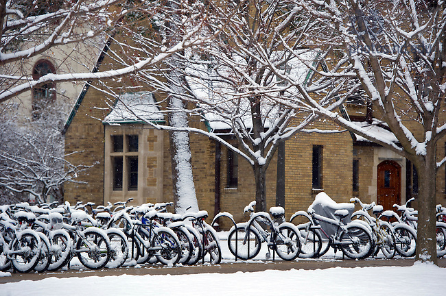 December 9, 2011; Snow covered bicycles parked in south quad. Photo by Barbara Johnston/University of Notre Dame.