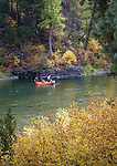 Fishermen in a raft on the Blackfoot River in western Montana. Fly fishing for trout.