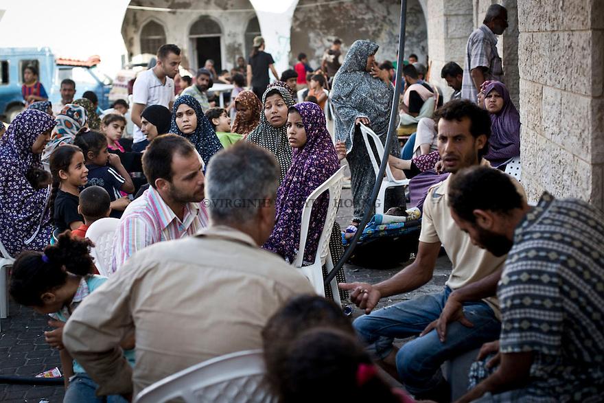 GAZA: The courtyard of the Saint Porphyrios Church is crowded of refugees. Everyday, more people arrive as shellings doesn't stop in some area of Gaza. <br /> <br /> GAZA: La cour de l'&eacute;glise Saint Porphyre est bond&eacute;e de r&eacute;fugi&eacute;s. Tous les jours, de nombreuses personnes arrivent car les  bombardements ne s'arr&ecirc;tent pas dans certaines zones de la bande de Gaza.