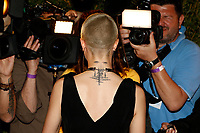 Model Cara Delevigne arrives at the Magnum X Moschino party during the 70th Annual Cannes Film Festival at Plage l'Ondine in Cannes, France, on 18 May 2017. Photo: Hubert Boesl - NO WIRE SERVICE · Photo: Hubert Boesl/dpa /MediaPunch ***FOR USA ONLY***