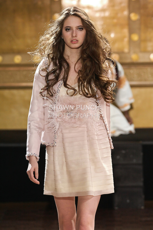 Model walks runway in an outfit by Paulina Polonyova, during the Slovak Fashion Night fashion show, May 13, 2011.