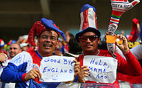 A Costa Rica supporter holds up a sign saying 'Good Bye England' as his sides victory eliminates England from the World Cup