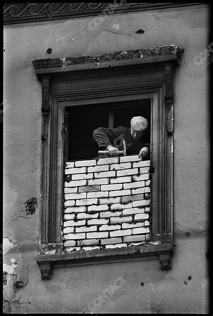 Windows in East Berlin near the construction of the Berlin Wall are bricked up. Viewed from West Berlin, German, November 196