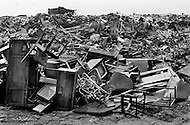 Manhattan, New York City, NY. September 1st, 1967. <br /> Discarded furniture and other city waste in a huge junk yard in the Bronx.