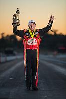 Nov 13, 2016; Pomona, CA, USA; NHRA top fuel driver Doug Kalitta poses for a portrait as he celebrates after winning the Auto Club Finals at Auto Club Raceway at Pomona. Mandatory Credit: Mark J. Rebilas-USA TODAY Sports
