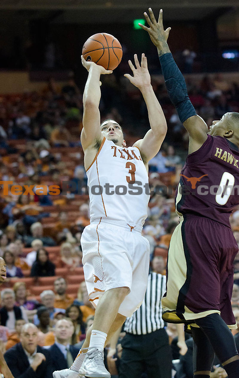 Dec 15, 2012; Austin, TX, USA; Texas Longhorns guard Javan Felix (3) shoots against the Texas State Bobcats during the second half at the Frank Erwin Special Events Center. Texas beat Texas State 75-63. Mandatory Credit: Brendan Maloney-USA TODAY Sports