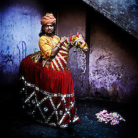 Ravi Bhatt is a Horse-Dancer in the Kathputli Colony. Located in northwest Delhi, Kathputli is inhabited by approximately 2,000 performing artists, practicing traditional art forms such as marionette puppetry, juggling, magic, acrobatics, dance and music. Many have travelled all over the world showcasing their abilities, but they still choose to remain living in this slum, which is one of the most impoverished in the city.