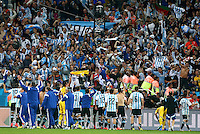 Argentina players celebrate winning the penalty shootout infront of their supporters