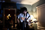 September 27, 2009. Durham, North Carolina..A house show at Craig's featuring Yusuuf Jerusalem, Thomas Function and Spider Bags.