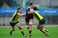 Sauimoana Solia of New Zealand takes on the Australia defence. FISU World University Championship Rugby Sevens Women's 9th/10th place match between New Zealand and Australia on July 9, 2016 at the Swansea University International Sports Village in Swansea, Wales. Photo by: Patrick Khachfe / Onside Images