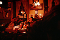 Mexicans gather at a popular local bookstore/coffee house in Puebla to drink, smoke, talk and take in the ambiance.  A trendy meeting place with a casual club atmosphere draws a young crowd to listen talk, eat and drink while listening to live music.
