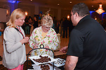 WATERBURY, CT-042017JS02- Sue Mellitt of MacDermid Performance Solutions in Waterbury, left, and Ellen Lynch, Principal of Children's Community School in Waterbury, center, talk with Carmen Romeo of Fascia's Chocolates, during the 23rd annual Wine & Beer Tasting Fundraiser Wednesday at La Bella Vista in Waterbury. The event, hosted by the Waterbury Exchange Club Charitable Foundation, was chaired by Virginia O'Rourke Cookson of O'Rouke & Birch Flower Shop and Cathy Chaikowsli of Webster Bank and featured wine and beer by Nutmeg Fine Wine & Spirits. Jim Shannon Republican-American