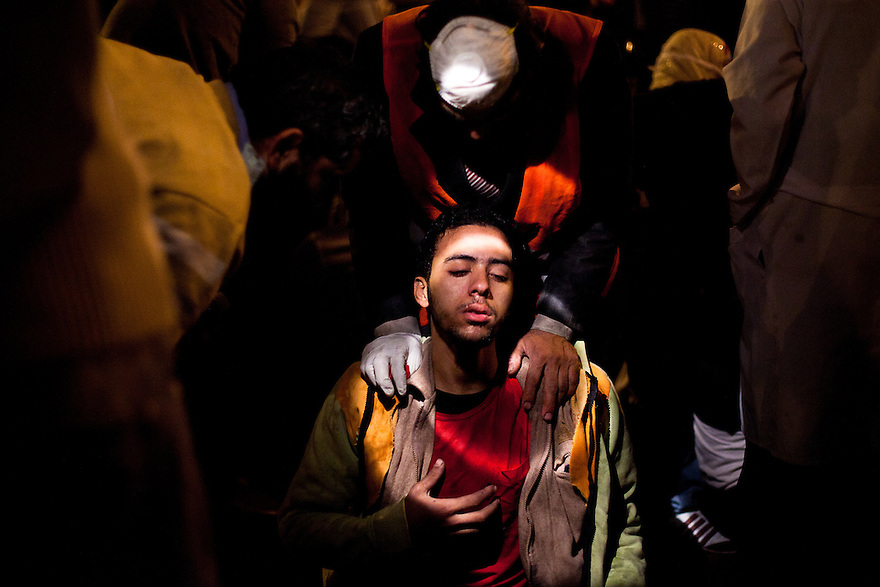 "November 22, 2011 – Cairo, Egypt - Protestors receive medical care at field hospitals set up around Tahrir square to deal with the increasing number of injuries. Most suffer from the extreme side effects of the type of tear gas used by the police, while others have bullet wounds from real and rubber bullets. Protest organizers called today for a ""million man march,"" thousands turned out. Egypt's military leader promised a faster transition to civilian rule, saying Tuesday that presidential elections will be held by the end of June 2012. But the major concession was immediately rejected by tens of thousands of protesters in Cairo's Tahrir Square who responded with chants of ""leave, leave"" now. Photo credit: Trevor Snapp"