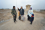 Fleeing the Islamic State, a family talks with an Iraqi soldier after walking into government-controlled territory in Mosul, Iraq, on January 27, 2017. The Iraqi army, including elite counter-terror commandos, drove the Islamic State group out of the eastern part of the city in early in 2017. Despite the city's new freedom, Christians are unlikely to return soon due to concerns about their security in the largely Sunni Muslim community.