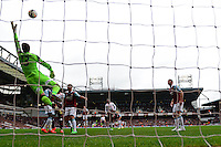 West Ham's goalkeeper Adrian looks on as a shot from Liverpool's forward Luis Suarez hits the cross bar  - Photo mandatory by-line: Mitch Gunn/JMP - Tel: Mobile: 07966 386802 06/04/2014 - SPORT - FOOTBALL - Boleyn Ground - London - West Ham United V Liverpool - Barclays Premier League