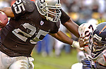 Oakland Raiders running back Charlie Garner (25) stiff-arms Denver Broncos defensive back Nick Ferguson (25) on Sunday, November 30, 2003, in Oakland, California. The Broncos defeated the Raiders 22-8.