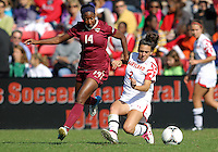 COLLEGE PARK, MD - OCTOBER 21, 2012:  Domenica Hodak (2) of the University of Maryland gets the ball from Tiffany McCarty (14) of Florida State during an ACC women's match at Ludwig Field in College Park, MD. on October 21. Florida won 1-0.