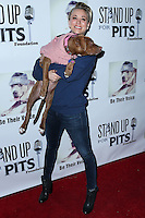 LOS ANGELES, CA, USA - NOVEMBER 02: Actress Kaley Cuoco arrives at the 2014 Stand Up For Pits Event held at Improv on November 2, 2014 in Los Angeles, California, United States. (Photo by Xavier Collin/Celebrity Monitor)