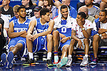 Members of the Kentucky alumni team talk to current point guard Tyler Ulis during the second half of the Alumni Charity Game against the Carolina Tarheels Alumni at Rupp Arena on Sunday, September 13, 2015 in Lexington, KY. UK alumni defeated UNC alumni 122-115. Photo by Taylor Pence | Staff
