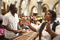 Switzerland. Canton Valais. St-Maurice. Africa Saints Pilgrimage (P&egrave;lerinage aux Saints d'Afrique). Religious <br /> ceremony in St-Maurice's abbey. African women and men gather for a catholic mass. They sing, dance and listen to music payed by drums and balafon instruments. The balafon (bala, balaphone) is a resonated frame, wooden keyed percussion idiophone of West Africa. The balafon is part of the idiophone family of tuned percussion instruments. Sound is produced by striking the tuned keys with two padded sticks. 2.06.13 &copy; 2013 Didier Ruef