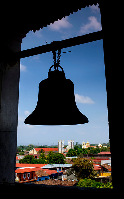 Silhouette of a bell in the bell tower of the 1878 Santuario de Nuestra Senora Guadalupe frames downtown Chinandega, Nicaragua.