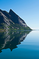Mountain reflection in Kjerkfjord, Reine, Lofoten islands, Norway