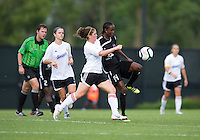 Esther Anyanwu (14) of the Virginia Beach Piranhas fights for the ball with Emily Parisi (14) of the Fredericksburg Impact during the game at the University of Mary Washington Battleground Stadium in Fredericksburg, VA.   The Virginia Beach Piranhas defeated the Fredericksburg Impact, 2-0, in a weather shortened game.