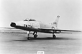 """The F-100 """"Super Sabre"""" was the United States Air Force's (USAF) first operational aircraft capable of flying faster than the speed of sound (760 miles per hour) in level flight. It made its initial flight on May 25, 1953 and the first production aircraft was completed in October 1953. North American built 2,294 F-100s before production ended in 1959.   Designed originally to destroy enemy aircraft in aerial combat, the F-100 later became a fighter-bomber. It made its combat debut during the Vietnam conflict where it was assigned the task of attacking such targets as bridges, river barges, road junctions, and areas being used by infiltrating enemy soldiers. .Credit: U.S. Air Force via CNP"""