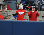 Ole Miss fan Matt Lowry, who dresses as movie character Michael Myers when pitcher Mike Mayers pitches, holds a broom after the Ole Miss vs. Houston at Oxford-University Stadium in Oxford, Miss. on Sunday, March 11, 2012. Ole Miss won 11-3 to sweep the three-game series.