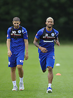 Adel Taarabt and Armand Traore of QPR in training