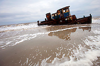 LITTLE ST. SIMONS ISLAND, FL -- October 2, 2010 -- A shipwrecked tugboat ages in the surf on Little St. Simons Island on Saturday, October 2, 2010.   The 10,000 acres of marshland, beaches, and forests are a refuge for wildlife and vacationers alike with only 32 guests permitted a night.  (Chip Litherland for Bay Magazine)