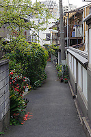 """Yanaka, Tokyo, Japan, April 19, 2012. Yanaka is part of Tokyo's """"shitamachi"""" historic working class wards. Recently it has become popular with Japanese and foreign tourists for its many temples, shops, restaurants and relaxed atmosphere."""